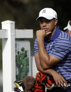Tiger Woods waits out a delay during the pro-am at the Farmers Insurance Open golf tournament in San Diego, Wednesday, Jan. 26, 2011. (AP Photo/Lenny Ignelzi)