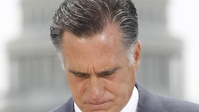 With the Capitol in the background, Republican presidential candidate, former Massachusetts Gov. Mitt Romney pauses while speaking about the Supreme Court's health care ruling, Thursday, June 28, 2012, in Washington. (AP Photo/Charles Dharapak)