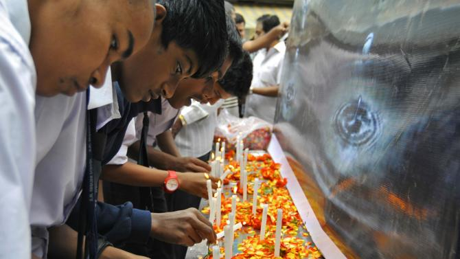 School children light candles to pay tribute to the victims of the attack at the military-run Army Public School at Peshawar in Pakistan, in Bengaluru