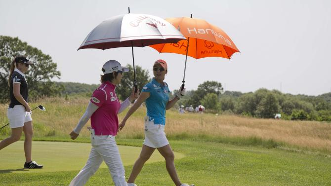 So Yeon Ryu, right, and Eun-Hee Ji walk to the second fairway with Paula Creamer, left, during the first round of the U.S. Women's Open golf tournament, Thursday, July 5, 2012, in Kohler, Wis. (AP Photo/Julie Jacobson)