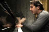 Turkish pianist and composer Fazil Say plays on February 9, 2010 at the Theatre des Champs-Elysees in Paris. Say has been the target of public outrage when he posted tweets denouncing what he branded the hypocrisy of the pious in Turkey