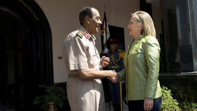 Field Marshal Hussein Tantawi, left, greets US Secretary of State Hillary Rodham Clinton before a meeting at the Ministry of Defense July 15, 2012 in Cairo, Egypt. Clinton is holding talks with Egypt's top military leaders to press for the military to work with Egypt's new Islamist leaders on a full transition to civilian rule. (AP Photo/Brendan Smialowski, Pool)