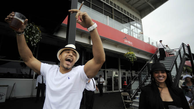 Robert Mone, from the Brooklyn borough of New York, celebrates as Zee Bros wins the sixth horse race at Pimlico Race Course, Saturday, May 18, 2013, in Baltimore. The 138th Preakness Stakes horse race takes place Saturday. (AP Photo/Mike Stewart)