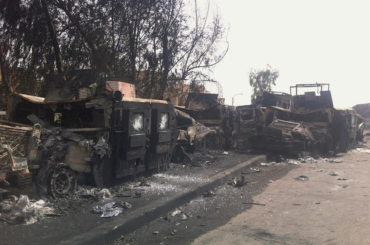 Burned Iraqi army armored vehicles are seen left on a street of the northern city of Mosul, Iraq, Thursday, June 12, 2014. The al-Qaida-inspired group that captured two key Sunni-dominated cities in Iraq this week vowed on Thursday to march on to Baghdad, raising fears about the Shiite-led government's ability to slow the assault following the insurgents' lightning gains. (AP Photo)