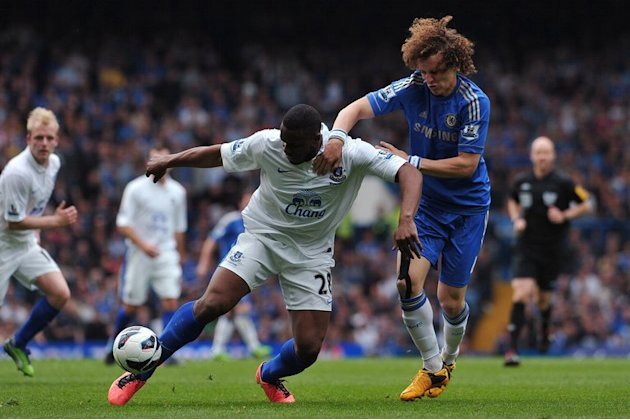 Everton's Victor Anichebe (L) tries to fend off Chelsea's David Luiz at Stamford Bridge on May 19, 2013