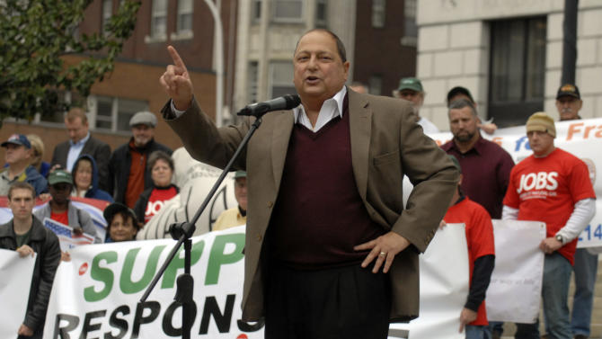 New York state Sen. Thomas Libous, R-Binghamton, speaks at a rally in favor of responsible natural gas drilling in New York outside the Capitol in Albany, N.Y. on Monday, Oct. 15, 2012. (AP Photo/Tim Roske)