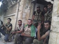 Members of the Free Syrian Army pose for the photographer as they rest in Aleppo September 2, 2012. Picture taken September 2, 2012. REUTERS/Shaam News Network/Handout