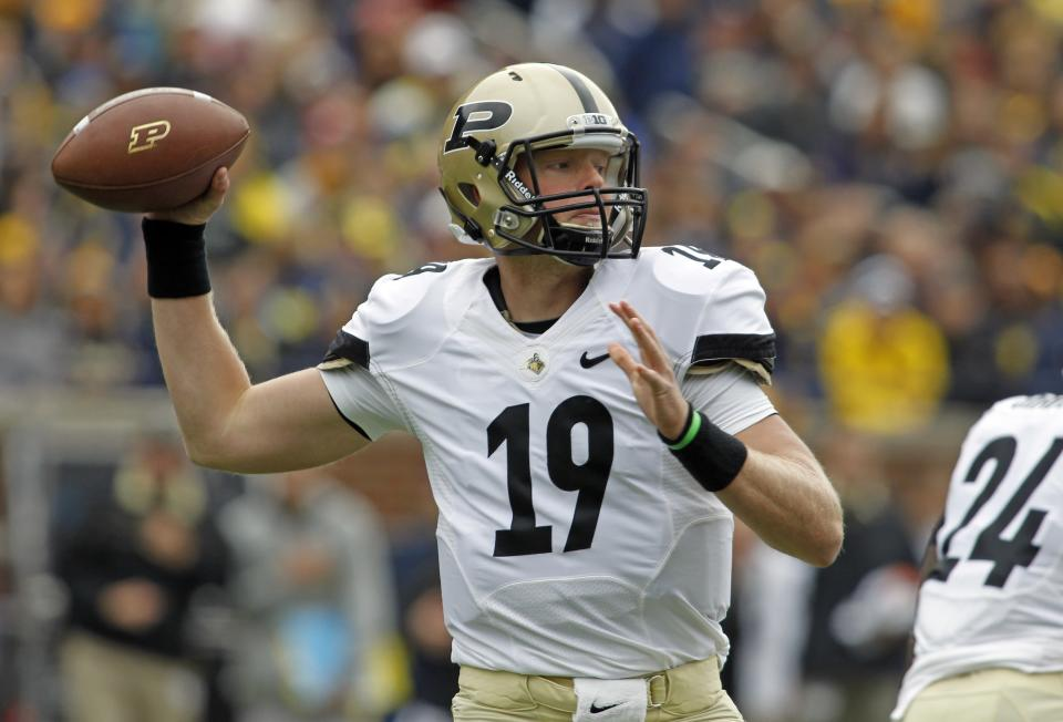 Purdue quarterback Caleb TerBush (19) throws a pass in the first quarter of an NCAA college football game against Michigan, Saturday, Oct. 29, 2011, in Ann Arbor, Mich. (AP Photo/Tony Ding)