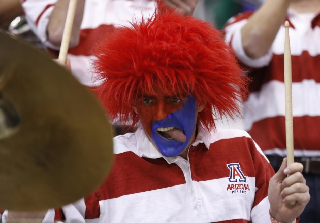 Arizona band member Tony Gonzalez plays the drums before the first half of their third round NCAA tournament basketball game against Harvard in Salt Lake City, Utah