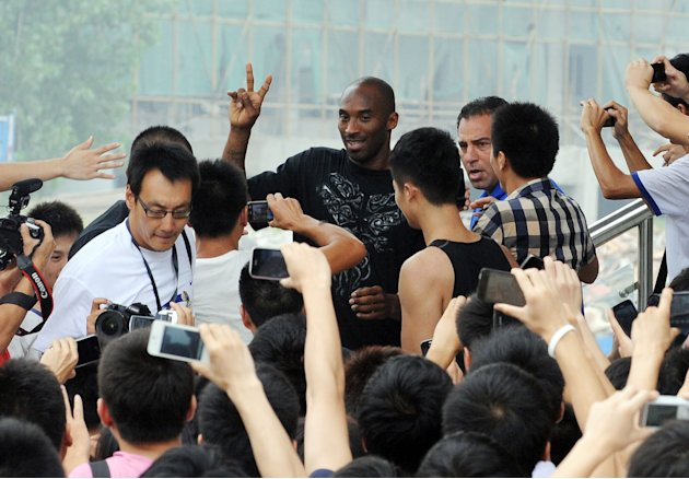 US NBA star Kobe Bryant gestures to his