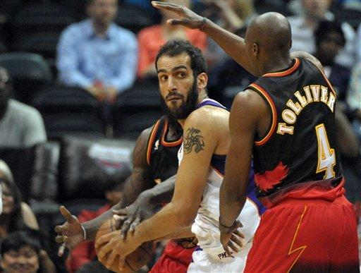 Smith has double-double, Hawks beat Suns, 107-94