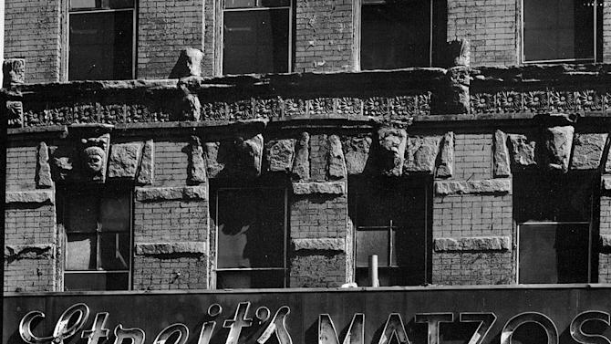 CORRECTS NUMBER OF MATZOS TO 2.5 MILLION- FILE-This file photo from the early 1960s,  provided by the Streit's factory in New York, shows the storefront of the matzo factory at the corner of Rivington St. and Suffolk St. in New York's Lower East Side. Streit's is the oldest factory building in the United States where the unleavened flatbread that's an essential element of Jewish holidays is still churned out. Nearly 2.5 million matzos were baked for April's Passover holiday, and distributed worldwide. Streit's is now counting the days before it closes its eight-decade-old ovens and moves to a 21st century computerized plant somewhere in the New York area.  (AP Photo/Streit's,File)