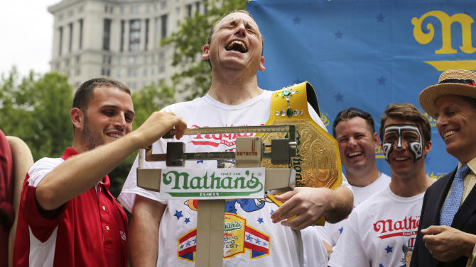 Joey Chestnut stands on the scale during the official weigh-in