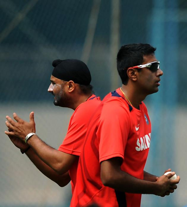 Indian cricketers Harbhajan Singh (L) an