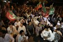 Pakistanis chant slogans during a protest to condemn the killing of Zohra Shahid, a senior member of former Pakistani cricket star Imran Khan's Pakistan Tehreek-e-Insaf party in Sindh, in Karachi, Pakistan, Sunday, May 19, 2013. Police said gunmen on a motorcycle shot and killed Shahid outside her home on Saturday, May 18, 2013, in the city of Karachi in southern Sindh province. (AP Photo/Fareed Khan)
