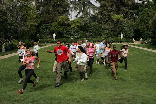 Teams race from the start at the Playboy Mansion during The Amazing Race 12.