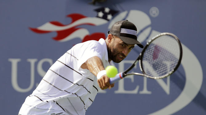 FILE - In this Aug. 27, 2012 file photo, James Blake returns a shot to Lukas Lacko, of Slovakia, in the first round of play at the 2012 US Open Tennis tournament in New York. Blake says he will retire from tennis after the U.S. Open. The 33-year-old Blake announced his decision at a news conference at Flushing Meadows on Monday, Aug. 26, 2013, the opening day of the year's last Grand Slam tournament. (AP Photo/Kathy Willens, File)
