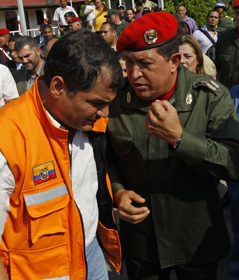 Venezuela's President Hugo Chavez, right, speaks with Ecuador's President Rafael Correa during a welcoming ceremony at the Fort Tiuna military base in Caracas, Venezuela, Tuesday, Dec. 14, 2010. Correa is in Venezuela for a one-day visit. (AP Photo/Fernando Llano)
