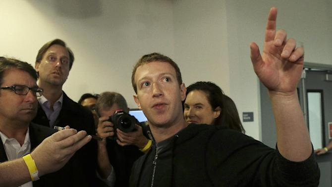 """Facebook CEO Mark Zuckerberg answers questions after speaking at Facebook headquarters in Menlo Park, Calif., Tuesday, Jan. 15, 2013.  Zuckerberg introduced """"graph search"""" Tuesday, a new service that lets users search their social connections for information about their friends' interests, and for photos and places.  (AP Photo/Jeff Chiu)"""