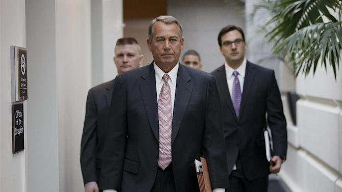 House Speaker John Boehner of Ohio, walks to the weekly House Republican Conference on Capitol Hill in Washington, Wednesday, March 12, 2014. After months of railing against President Barack Obama's health care overhaul, Republicans scored a key victory in a hard-fought congressional race in a Florida special election Tuesday that largely turned on the federal health care law and that had been closely watched as a bellwether of midterm elections in November. (AP Photo/J. Scott Applewhite)