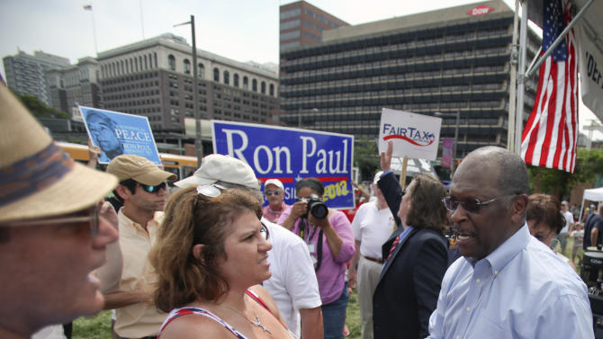 "Republican presidential candidate Herman Cain shakes hands with supporters during the ""Energy Independence Day Tea Party"" rally on Independence Mall in Philadelphia, on Monday July 4, 2011. (AP Photo/Joseph Kaczmarek)"