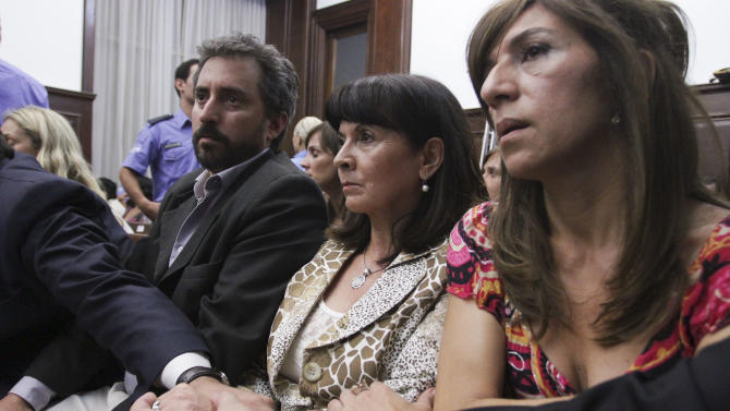 Susana Trimarco, second from right, is comforted by friends and lawyers as they listen to the verdict during the trial of the alleged kidnappers of her daughter Marita Veron in San Miguel de Tucuman, Argentina, Tuesday, Dec. 11, 2012. The 13 defendants, who were charged with kidnapping and forcing Veron to be a prostitute in 2002, were found innocent. (AP Photo/Atilio Orellana)