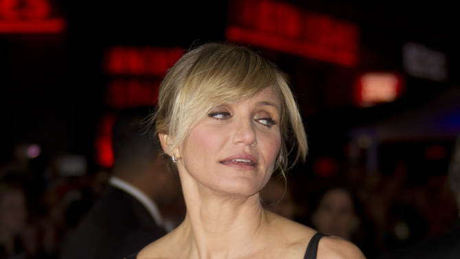 Cameron Diaz arrives for the World Premiere of Gambit at the Empire cinema in central London, Wednesday, Nov. 7, 2012. (Photo by Joel Ryan/Invision/AP)