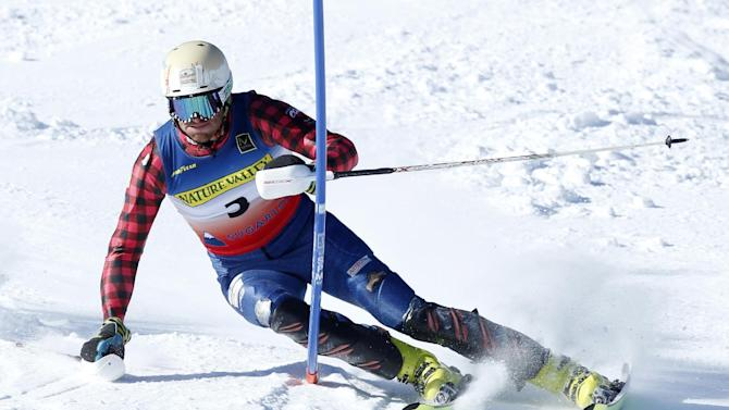 Tim Kelley, of Starksboro, Vermont, hits a gate on his way to a third-place finish in the men's slalom ski race at the U.S. Alpine Championships, Sunday, March 29, 2015, at Sugarloaf Mountain Resort in Carrabassett Valley, Maine. (AP Photo/Robert F. Bukaty)