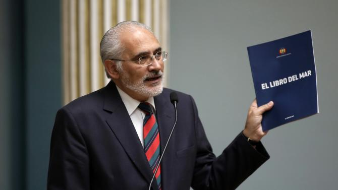 """Mesa, former Bolivian president and spokesman for Bolivia's maritime demand, holds a copy of """"The Book of the Sea"""" during an announcement about a nationwide distribution of the book, in La Paz"""