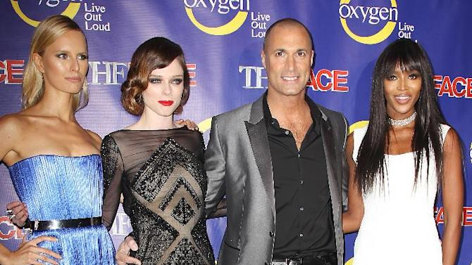 """This Feb. 5, 2013 photo released by Starpix shows models, from left, Karolina Kurkova, Coco Rocha and Naomi Campbell, right, pose with photographer Nigel Barker at the premiere of the Oxygen network series, """"The Face,"""" in New York. Campbell, Rocha and Kurkova are coaches to aspiring models in a competition to find the next face of beauty retailer ULTA Beauty. The show, hosted by Barker, premieres on Feb. 12 at 9 p.m. EST on Oxygen.  (AP Photo/Starpix,  Kristina Bumphrey)"""