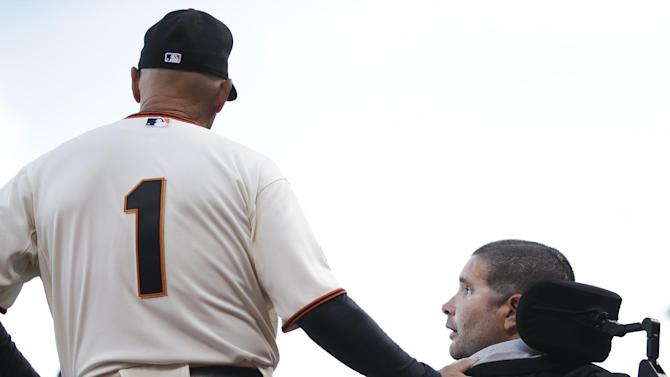 San Francisco Giants third base coach Tim Flannery chats with San Francisco Giants fan Bryan Stow before Game 4 of baseball's World Series Saturday, Oct. 25, 2014, in San Francisco. Stow was disabled after an attack by Los Angeles Dodgers fans following a baseball game between the San Francisco Giants and Dodgers in San Francisco. (AP Photo/Matt Slocum)