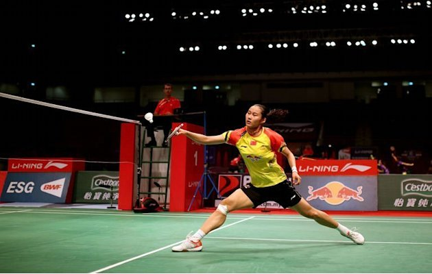 China's Wang Yihan returns against P. V. Sindhu of India at the 2013 Sudirman Cup in Kuala Lumpur on May 19, 2013