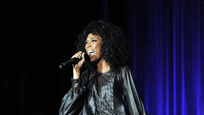 """R&B star Brandy performs at the AIDS Healthcare Foundation's """"Keep The Promise On AIDS"""" March and Rally, on Saturday, May 11, 2013 in Cleveland, Ohio. (David Richard /AP Images for AIDS Healthcare Foundation)"""