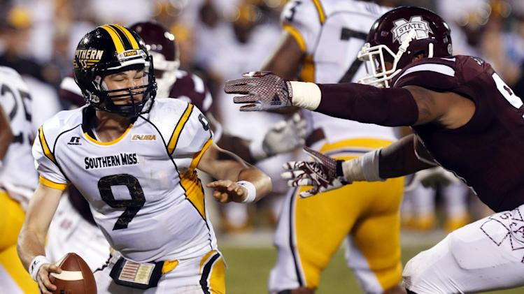 In this Aug. 30, 2014, photo, Southern Mississippi quarterback Nick Mullens (9) is pursued by Mississippi State defensive lineman Preston Smith, right, in the first half of an NCAA college football game at Davis Wade Stadium in Starkville, Miss. Smith was named the SEC's Defensive Lineman of the Week after his performance that included an interception and a blocked field goal in the team's 49-0 win