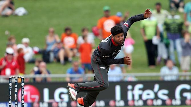 UAE's Muhammad Naveed bowls during the Cricket World Cup match against Pakistan in Napier on March 4, 2015