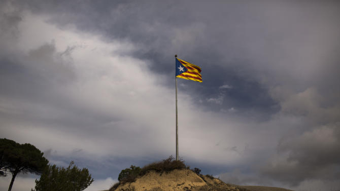 "In this photo taken on Saturday, Nov. 10, 2012, a pro-independence ""estelada"" flag is seen on top of a mountain near Hostalets de Balenya, a village declared by the city council a ""free Catalan territory"" in Spain. Catalonia holds elections on Sunday that will be seen as a test of the regional government's plans to hold a referendum on independence, and one of the key issues emerging is the theoretical place of a free Catalonia in Europe. (AP Photo/Emilio Morenatti)"