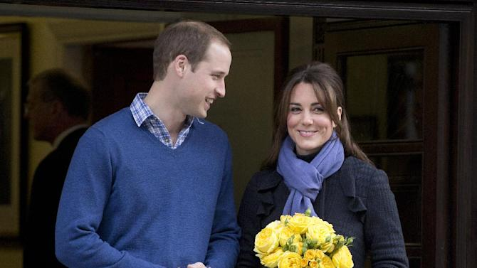 FILE - In this Thursday, Dec. 6, 2012 file photo Britain's Prince William stands next to his wife Kate, Duchess of Cambridge as she leaves the King Edward VII hospital in central London. Palace officials say Prince William and the former Kate Middleton's first baby is due in July and that her condition is improving. (AP Photo/Alastair Grant, File)