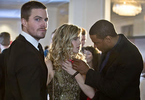 Stephen Amell, Emily Bett Rickards, David Ramsey | Photo Credits: Cate Cameron/The CW