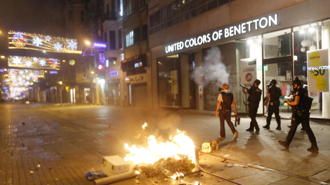 Riot policemen shoot tear gas during clashes with protesters near Taksim Square in Istanbul, Turkey, Saturday, June 22, 2013. (AP Photo/Petr David Josek)