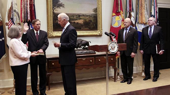 Vice President Joe Biden, center, administers the oath of office to Dir. of the CIA David Petraeus, as Holly Knowton Petraeus, left, holds a Bible, during a swearing-in ceremony in the Roosevelt Room of the White House in Washington, Tuesday, Sept., 6, 2011. Also in the room looking on are James Clapper, second from the right, Dir. of National Intelligence and John Brennan, far right, President Obama's chief counterterrorism adviser. (AP Photo/Pablo Martinez Monsivais)