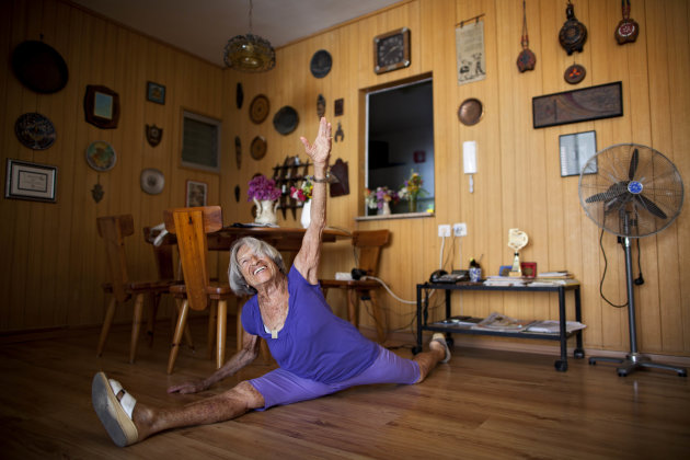 Agnes Keleti, a 91-year-old former Olympic gymnast, performs a split at her house in Herzliya, Israel, Monday, Aug. 13, 2012. Keleti won 10 Olympic medals, including 5 gold medals, while she represent
