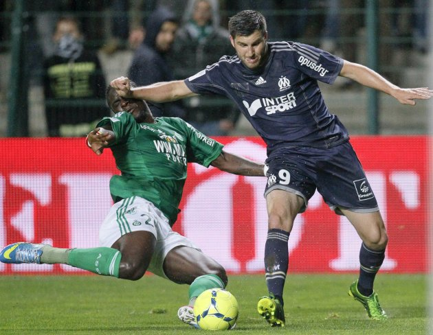 Gignac of Olympique Marseille challenges Sall of St Etienne during their French Ligue 1 soccer match at the Geoffroy Guichard stadium