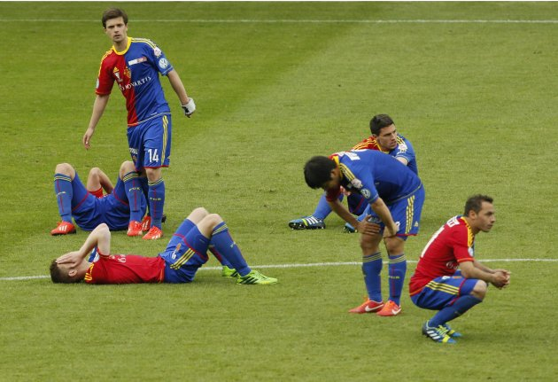 FC Basel players sit dejected on the pitch after losing the Swiss Cup final soccer match against Grasshopper in Bern