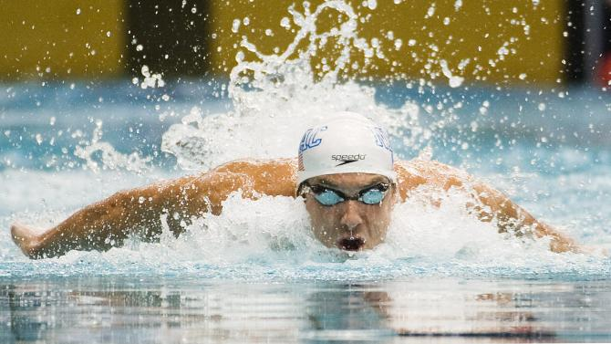 U.S. swimmer Michael Phelps competes during the 100-meter butterfly event at the Canada Cup swim meet in Montreal, Sunday, July 3, 2011.(AP Photo/The Canadian Press, Graham Hughes)