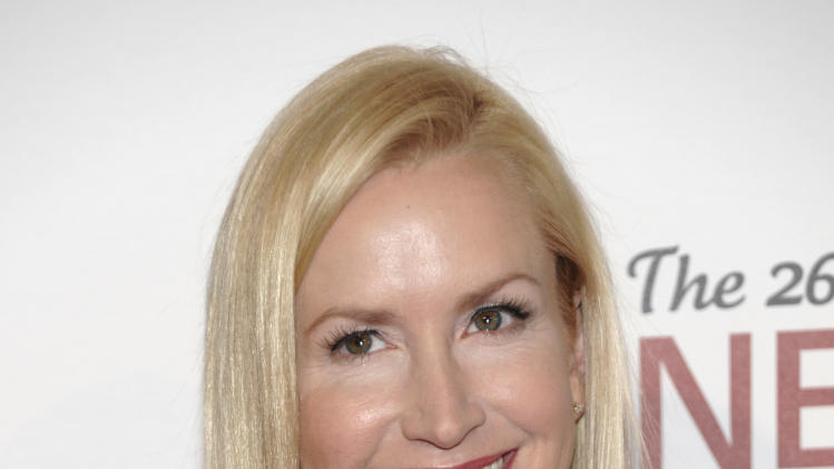 Actress Angela Kinsey arrives at The 26th Annual Genesis Awards benefiting The Humane Society in Beverly Hills, Calif. on Saturday, March 24, 2012. (AP Photo/Dan Steinberg)
