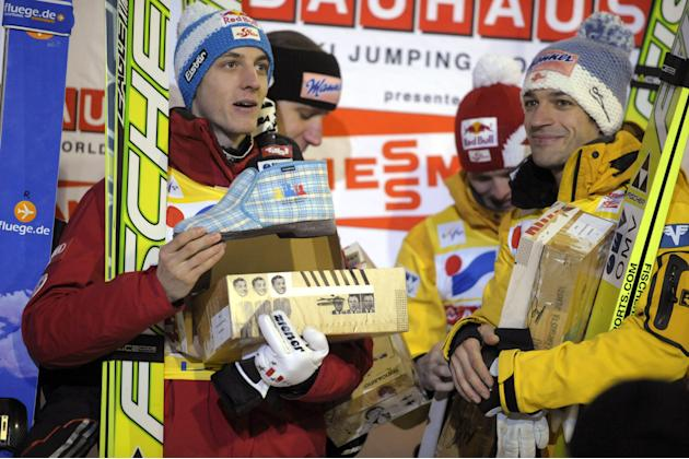 Austria's Gregor Schlierenzauer, Martin Koch, Thomas Morgenstern and Andreas Kofler celebrate after winning the Ski Jumping team competition event of the FIS World Cup Lahti Ski Games in Lahti on Marc