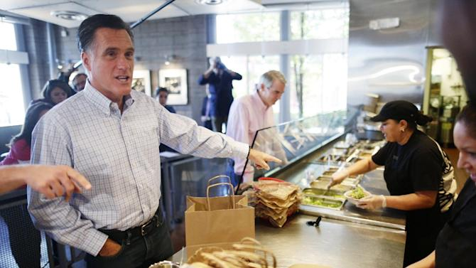 Republican presidential candidate, former Massachusetts Gov. Mitt Romney and Sen. Rob Portman, R-Ohio, center, make an unscheduled stop at a Chipotle restaurant in Denver, Tuesday, Oct. 2, 2012. (AP Photo/Charles Dharapak)
