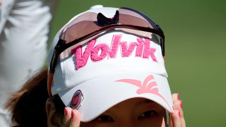 Chella Choi, of South Korea, lines up a putt on the third hole during the third round of the Canadian Women's Open LPGA golf tournament at Vancouver Golf Club in Coquitlam, British Columbia, on Saturday, Aug. 25, 2012. (AP Photo/The Canadian Press, Darryl Dyck)