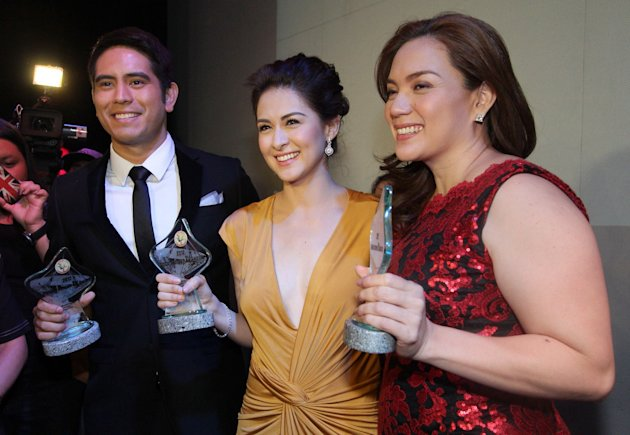 (L-R) Gerald Anderson, Marian Rivera and Slyvia Sanchez during the 2013 Golden Screen Awards for Television, held at the Teatrino in Greenhills, San Juan City, east of Manila, on 01 March 2013. (Czeasar Dancel/NPPA Images)