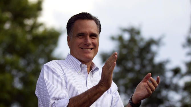 Republican presidential candidate, former Massachusetts Gov. Mitt Romney applauds during a campaign stop at Cornwall Iron Furnace on Saturday, June 16, 2012, in Cornwall, Pa. (AP Photo/Evan Vucci)